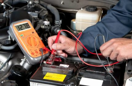 Why does an electric car need a 12-volt battery?